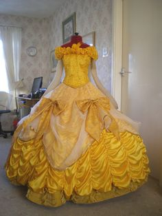 Belle's gold ball gown. Stunning Belle costume from Tracy's Costuming World. The petticoat is fantastic, too, and would work beautifully under other ball gowns.
