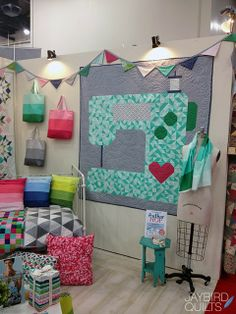 sewing machine quilt - would be cute on a smaller scale too! Love the colors and the heart.
