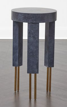KELLY WEARSTLER   MELANGE SIDE TABLE. In solid burnished brass, the cast legs feature a hand-wrought texture juxtaposed with hand-troweled plaster