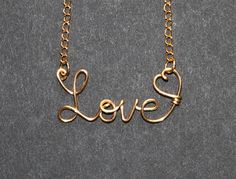 """Script """"love"""" necklace or whatever your able to spell with wire."""