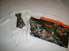 Camo Tie Onesie and Burp Cloth Daddy's New Hunting Buddy by grinsandgigglesbaby1, $19.99 Tie Onesie, Onesies, Baby Boy Camo, Camo Tie, Burp Cloths, Hunting, Daddy, Handsome, Trending Outfits