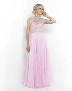 BLUSH PROM 9990 CRYSTAL PINK  Elegant sweetheart empire waist gown featuring a sheer illusion high neck beaded with clear crystals and AB stones. Layers of chiffon gather at waist and flow to the floor in this full length feminine and romantic style. Back zipper closure. Available in Crystal Pink, Ocean, and Persimmon.