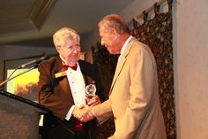 Sister Cities President Tom Halbert presents the One World Award to Nick Bollettieri as the individual who has enhanced world understanding and respect through extraordinary work or volunteer service 2012