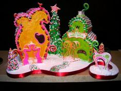 Whoville - Whoville gingerbread houses for a local contest (prize $1000!--wish me luck!) The buildings are gingerbread, sides covered with gumpaste. Lots of RI ! Trix, candy canes (reshaped!), fruit loops straws, nerds, etc etc etc!! Lots of fun, but should have started it three weeks earlier!  Wanted to make a grinch and max but didn't have time.