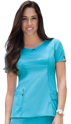 This missy fit round neck top features a small peek-a-boo opening below its neckline complimented with a tab and dyed-to match buttons. This sleek top has front yokes embellished with coverstitch details. Soft Works, Medical Uniforms, Scrub Tops, Princess Seam, Peek A Boos, Poplin, Dress Patterns, Scrubs, Caregiver