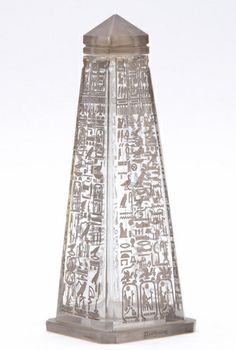 "BICHARA ""Ramses II"" Saint Louis crystal perfume bottle as an Egyptian obelisk with deeply impressed hieroglyphics and labeling, with silver gray luster patina, c. 1928."