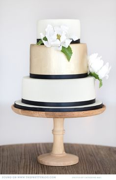 gorgeous black, gold + white cake