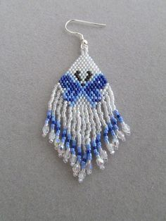 These stunning beaded earrings depict a beautiful Blue Butterfly. They measure 1-1/4 inches wide and are 2-1/2 inches long, excluding the ear wires and are woven using the brick stitch and approximately 892 tiny seed beads and 30 czech fire polish beads. Although some people find bead work tedious, I really love it. There is something so fascinating about stitching the beads in place, one by one and watching the picture develop.  They would make a great gift or maybe a treat for yourself…