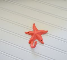 Coral hand painted Starfish wall hook is great for hanging towels, jewelry, leashes, keys or whatever you can think of. Made of cast iron,