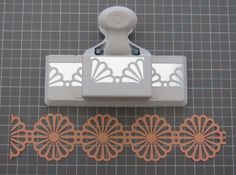 Paper punch chain garland using border punches (in this case Martha Stewart) by Jim Noonan at The Crafts Department.