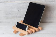 Keep four devices on your desk or counter with this wooden organizer.