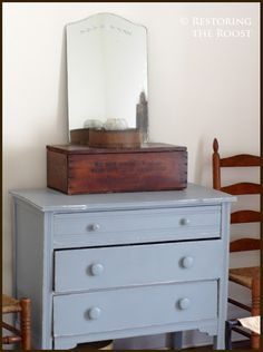 I topped the dresser this with an antique ammunition box that has a wonderful patina; a vintage sewing kit completes the trio.