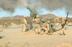 Marines with I Battery, 3rd Battalion, 12th Marines, 11th Marine Regiment, fire an M777 Howitzer during an artillery suppression support exercise in support of the Integrated Training Exercise aboard the Combat Center Nov. 13, 2013. Public Domain