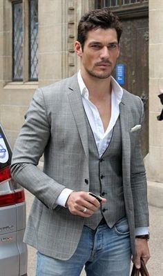 David Gandy. Suit coat and vest with open neck white shirt, jeans and white pocket square. Casually elegant.
