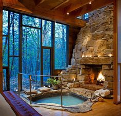 Indoor Jacuzzi And Fireplace. Not a jacuzzi fan but the fireplace and windows are beautiful.