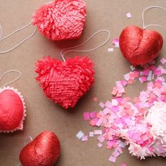 Using two nestled blown out chicken eggs, make a variety of wonderfully colorful crepe paper covered heart valentines. So festive!