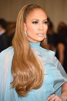 J.Lo,, the Queen of caramel colored hair, wore her locks pushed off the face into long waves.