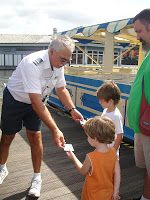 """Collect WDW trading cards-Few people know that water ferries, monorails, etc have their own trading cards. These include a picture & facts. You can ask a staff person (boat driver/monorail driver/attendant) if they have cards.  This guy not only gave my boys one card, but he went and found a whole set of Downtown Disney Ferry cards. The Walt Disney Railroad at the Magic Kingdom also gives out conductor passes. Kids can get a """"Driver's License"""" when they ride/drive at the Magic Kingdom's…"""