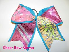 Teal and Pink Cheer Bow with Pink/Orange/Yellow Tie-Dye and Silver Accents by Cheer Bow Mama