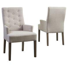 Birdie Spisebordsstol - Flot polstret spisebordsstol med betræk i hør og træben i røgfarvet eg. Stolen har lave armlæn og er flot dekoreret i ryggen med knapper. En spisebordsstol, der indbyder til lange middage i godt selskab.