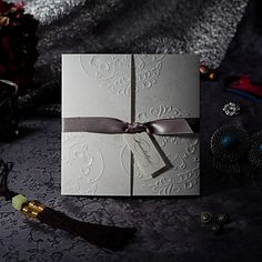 Elegant Embossed Tri-fold Wedding Invitation With Silver Bows (Set of 50) – USD $ 59.99