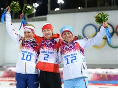 DAY 11:  (L-R) Silver medalist Gabriela Soukalova of the Czech Republic, gold medalist Darya Domracheva  of Belarus and bronze medalist Tiril Eckhoff of Norway during the flower ceremony for the Women's 12.5 km Mass Start