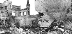 """""""Soviet soldiers find cover in piles of rubble from blasted buildings while engaging German forces in street fighting on the outskirts of Stalingrad in early 1943."""""""