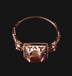 Engraved & enamelled gold ring with a ruby, Italy, late 16th century