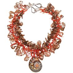 1stdibs   Nautilus pendant on a multi-strand necklace of gold corn flake pearls, gold cross/sword pearls, coral salvaged from a vintage piece and sterling silver (strands are 19, 20 and 22 inches) $1,875.
