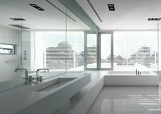 Partial view of a minimalist bathroom in Greece by ISV architects _