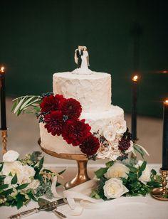 Simple cake adorned with beautiful burgundy dahlias