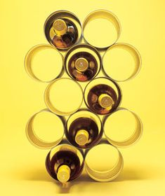 coffee cans as wine rack   http://www.realsimple.com