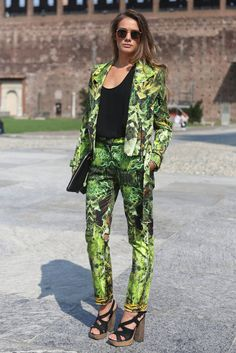 The printed suit was made entirely wearable with understated shades and a basic black tee.