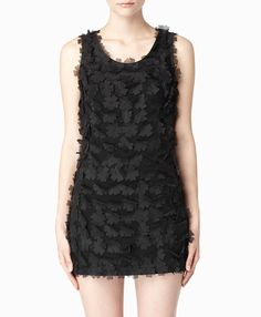 Black Dress Covered in Flower Shaped Cut-Outs.