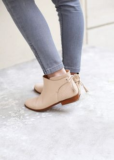 Grey jeans and neutral Chelsea boots
