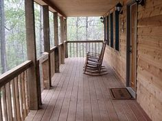 Rustic Porch. I would love to hang ferns, and sit in rocker!