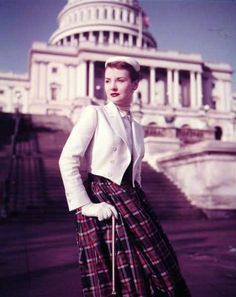 Spring 1952 - tartan skirt (maybe a dress idk) with a white blazer over it - kinda cute
