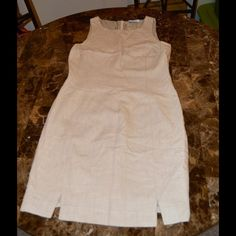 Valentino Miss V Dress Size 44 Euro or 10 USA Valentino Miss V Dress Beautiful Beige Perfect for Work or night two very cute slits in the front Size 44 Euro or 10 USA Cotton and Rayon Exterior Fully Lined Zipper Back Excellent Condition Item Location Bin D3 Valentino Dresses