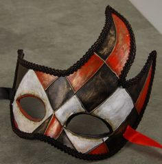 Red black and white Mardi Gras/Masquerade mask.