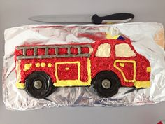 Fire engine cake using buttercream icing for 2 year old boys party