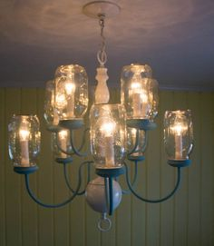 Cast a light over your dining room table with this innovative fixture. For those feeling a bit more daring, try using colored Mason jars instead. Get the tutorial at Marty's Musings.    - CountryLiving.com
