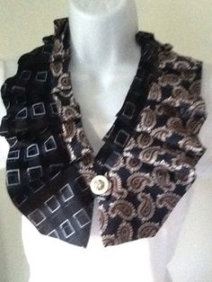 Upcycled mens necktie scarf. Snap closure. About 26 when snapped.