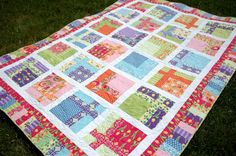 A fun modern quilts design that uses a stack of 10'' squares and 2-1/2'' strips.