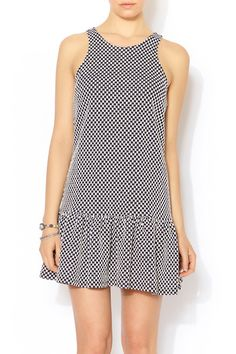 Checker print black and white fit n flare dress ($48).  Pair with red flats and a sleek ponytail for a cute and casual look! @shoptiques