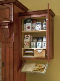 Keep recipes and cookbooks right where you need them with this handy organizer designed to fit right inside your cabinet.