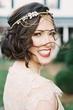 romantic wedding hair and make up with jeweled hair accessory
