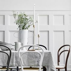 bentwood chairs. unique white vessels and vases