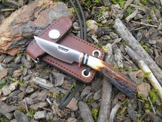 little Behring Made neck knife features a hand forged 440c stainless convex blade with a hand soldered copper guard.  behringmade.com