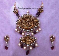 Intricately designed and exquisitely crafted gold necklace with huge step pendant adorning Vaikuntha Vishnu and Lakshmi with ruby and pearl beads Indian Jewelry Sets, Indian Wedding Jewelry, Bridal Jewelry, India Jewelry, Ethnic Jewelry, Gold Temple Jewellery, Gold Jewellery Design, Gold Jewelry, Designer Jewellery