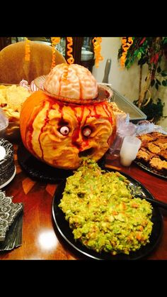 Halloween center piece. Guacamole and Jell-O shot brains. Yum!